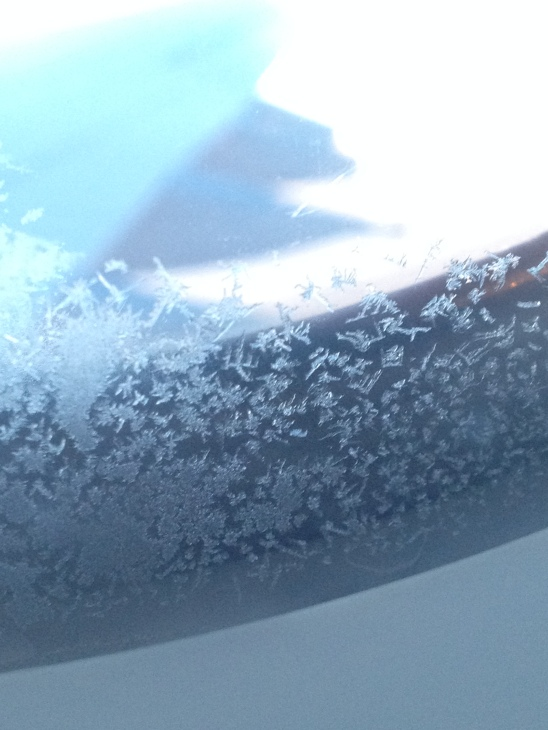 Ice crystals formed on my window while flying over the Atlantic.